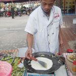 Jian Bing the breakfast egg wrap consumed on Chinese streets